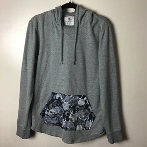 On the Byas gray hoodie with flowered pocket.M